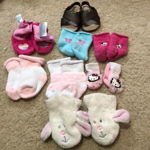 Bundle of new born socks, shoe, and bunny gloves